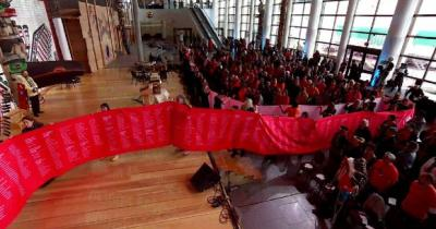 Photo of red cloth with names of children who died in residential schools