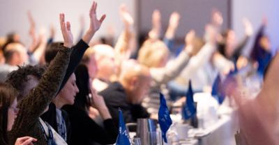 Photo of BPS Delegates' hands in the air