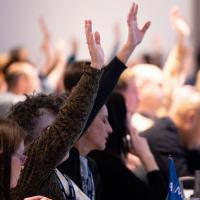 AMAPCEO members with raised hands at a conference